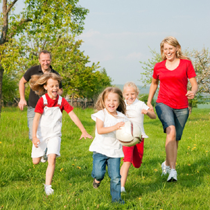 a pic of a happy family walking, to show you  some of the best weight loss exercises