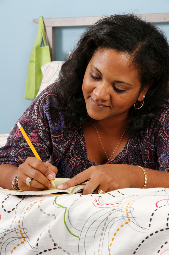 a woman journaling to help after scoring high on the emotional eating quiz