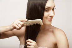 pic of a woman brushing her hair, showing how a skinny body type needs protein for hair, skin, nails etc.