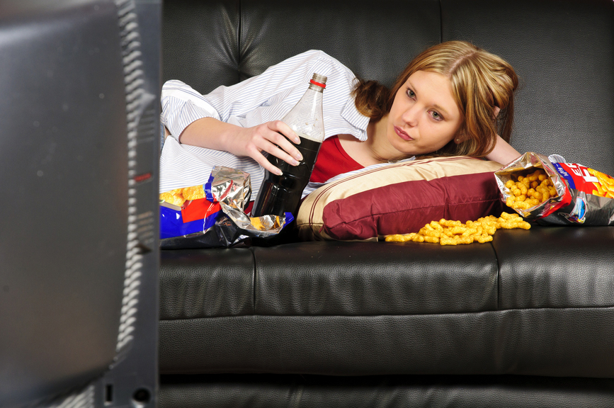 a woman eating junk to show the importance of taking the emotional eating quiz