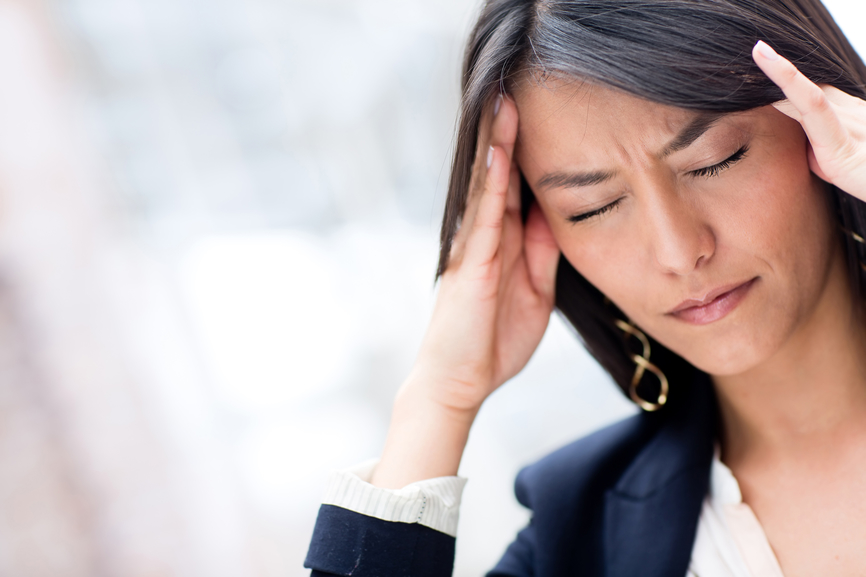 a pic of a woman with a headache as hypoglycemia is one of the weight gain causes