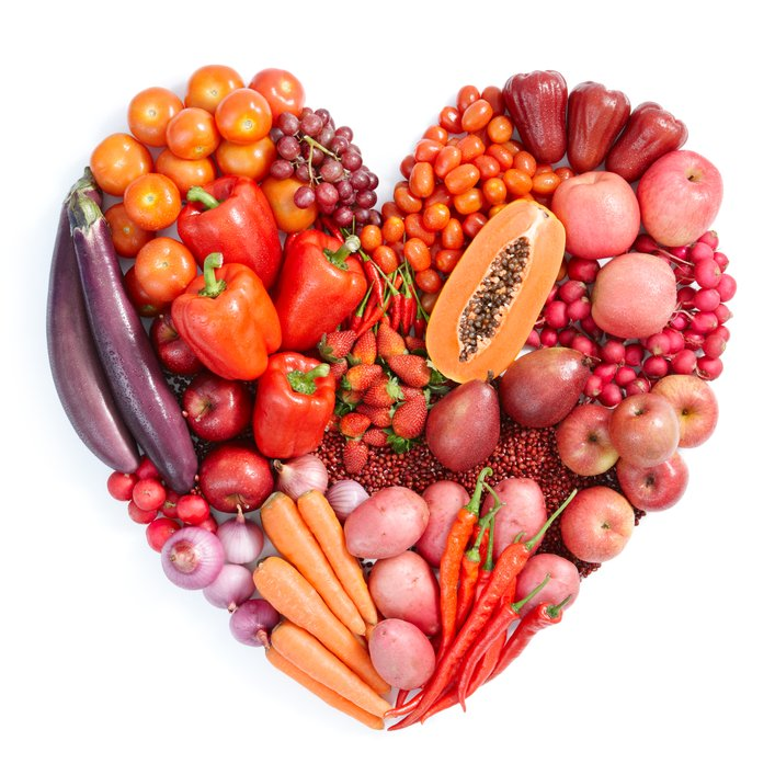 pic of a heart-shaped plate of red and orange vegetables for your healthy diet plan