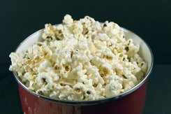 a pic of a large portion of popcorn as portion control is one of the weight gain causes