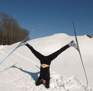 A pic of the author doing a headstand with cross country skis on showing how the West Island Naturopath loves to exercise and also loves snow